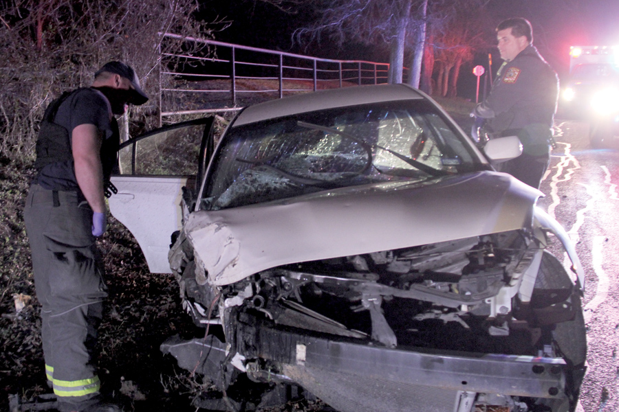 Car totaled as teens run from police