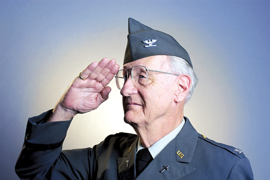 News collecting photos for Veterans Day Section